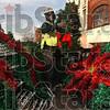 Duke Energy lineman Greg Madden picks out a wreath light set for hanging Wednesday on Wabash Avenue.