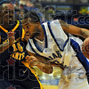 Coming through: Sycamore guard Rashad Reed drives past Murray State defender Kevin Thomas in first half action in the Hulman Center.