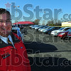 Dealer: Mark Fuson stands on the show lot with scores of new vehicles. Fuson's dealership sells several GM brands and understands the impact the auto industry has on the American economy.