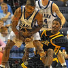 Mine: Isiah Martin grabs a loose ball from in front of Murray State's Issac Miles while Jordan Printy watches.