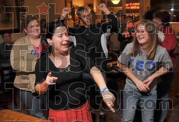 The hard work paid off: Obama campaign Field Organizer Rhea Marrie, second from left, celebrates with her fellow campaign workers, Mary Tallon, Sean Vogler and Chelsea Gibson after they learned Obama had won Vigo County Tuesday at the Saratoga.