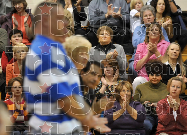 Thank you: Members of the audience applaud for members of the military, law enforcement and emergency rescue departments during a Veterans Day ceremony Monday at Honey Creek Middle School.