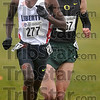 Neck and neck: When Liberty's Samuel Chelanga (277) and Oregon's Galen Rupp broke away from the pack but not from each other, the spectators at the Gibson Cross Country Championship Course knew they were in for a great race Monday.