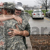 First things first: Michael Dickison of Marshall, Ill., hugs his son, U.S. Army Specialist Jonathon Dickison, after his arrival at the Army National Guard facility at 3614 Maple Avenue Monday.
