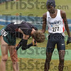 Good run: Liberty's Samuel Chelanga (277) reaches out to shake the hand of Oregon senior Galen Rupp afer they finished the men's 10,000-meter race second and first repectively Monday at the Gibson Cross Country Course.