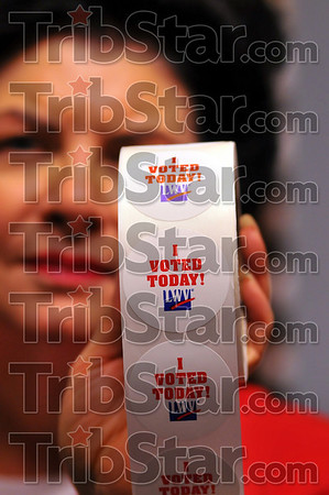 """You're in: Vigo County clerk Pat Mansard holds a roll of the League of Women Voters  """"I voted"""" stickers. In addition to getting one when you vote today, the stickers will be used to designate who was in line to vote when polls close at the end of the day, allowing them to vote."""