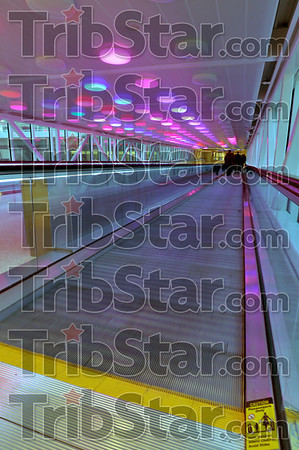 Don't trip: The moving walkway carrying travellers from the parking area to the terminal has scores of lights overhead that flash pink and blue and are activated by motion detectors.