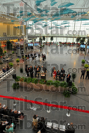 Gathering place: A great deal of attention was paid to the aesthetics of the Civic Plaza in the new Weir Cook terminal. It a a pre-security gathering and concesion place. At the bottom is part of 1.200 feet of red ribbon that was cut Tuesday at officially open the new air hub.