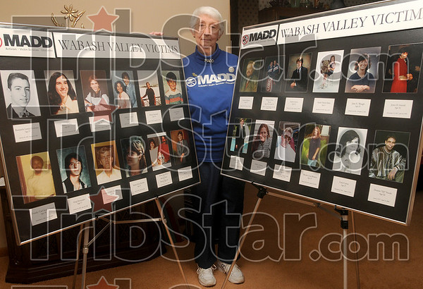 The tireless advocate: Marilyn Peffley helped bring a Mothers Against Drunk Driving chapter to the Wabash Valley in 1983 and retired in January after 25 years of service. Here, she poses for a photo with picture boards used by the organization to remember the victims killed by drunk drivers at her home Jan. 14.