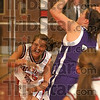 Shove defense: Terre Haute South's Randa Rector is physically forced out of bounds by the Bloomington South defense during the Braves' game against the Panthers Tuesday at South.