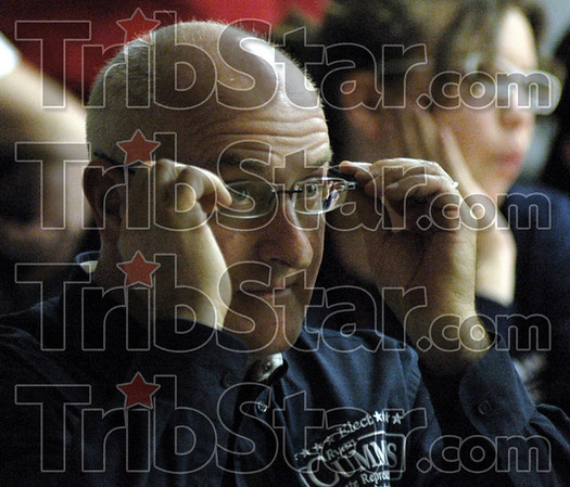 Adjustment: Ryan Cummins adjusts his glasses as he looks at election returns Tuesday night at the Greg Goode headquarters behind Honey Creek Square.