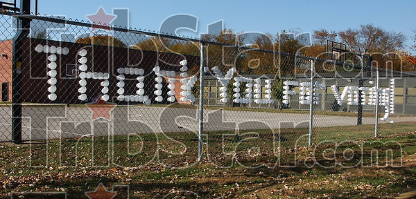 Duty done: Students at Meadows Elementary school constructed a thank you sign in a chain link fence near the polling place in the west end of their school.