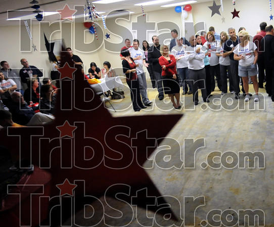 Star struck: Republican hopefuls watch early results of Tuesday night's election in the Greg Goode headquarters behind Honey Creek Square.