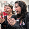 Campaign workers: Summer Gladden (center) and Nancy Deckard let their emotions show as they greet Greg Goode Tuesday night at his party headquarters.