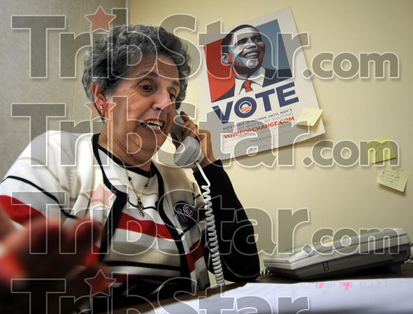 Last-minute:  Janice Bebush mans the telephone as she makes calls from the democrat headquarters in Sullivan late Tuesday afternoon.
