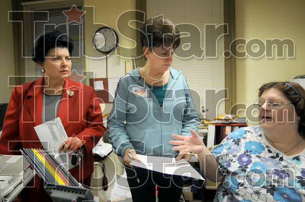 Countdown: Vigo Co. Clerk Pat Mansard (L) and two of her deputy clerks confer just minutes before the polls close Tuesday night.