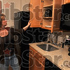 Perfect for the long stay: Candlewood Suites Director of Sales Teresa Brown shows off the amenities in the kitchen of a suite at the hotel Thursday.
