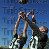 Competitive: West Vigo's Lucas Mackey (85) and Aaron Welch (80) leap for a ball prior to Thursday's practice at the school football field.