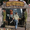 Store front for the festival: Jeff Thomas of Convoy, Ohio steps back to look over his and his wife, Cathy's stand, as they work on set up Thursday in Rockville for the Covered Bridge Festival.