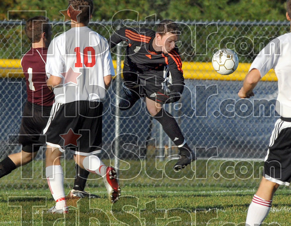 Save: South goalie Jordan Welsh leaps to catch an incoming kick during sectional action against Northview Thursday night at the North soccer facility.