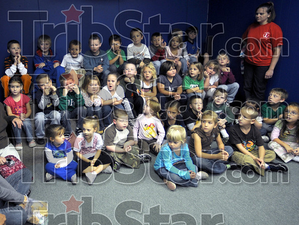 Kindergarten kids: Kindergarten students from West Vigo and Fayette elementary schools prepare to watch a video at the Children's Museum Thursday afternoon.