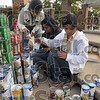 "World Food Day: India Student Association members Vyshnavi Paidipalli, Aishwarya Motiwale and Haritha Maringati build a replica of the Gateway to India as part of ""Canstruction"" Thursday on the Dede Plaza on the Indiana State campus."