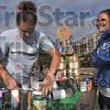 "Gooooal!: Indiana State Women's Soccer team members Emily Lahay and Eric Bianchi build a soccer player kicking a goal against rival Purdue out of cans for the team's ""Canstruction"" display Thursday on Dede Plaza."