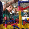 New friends: Kindergarten students Evan Wyrick of Fayette Elementary school (L) and Gabe McCallister from West Vigo Elementary school meet for the first time and play together at the Children's Museum Thursday afternoon.