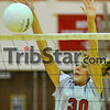 Net force: Woodrow Wilson's Brittney Pink blocks a hit in the Middle School Championship match Thursday night.