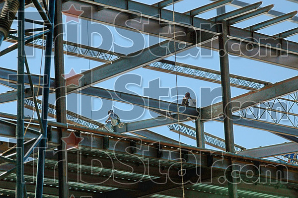Metal maze: Two Ironworkers are seen on the massive steel structure of the Union Hospital Thursday afternon.