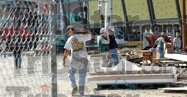 Hospital hustle: Construction personnel take care of business Thursday afternoon on the site of the Union Hospital project.