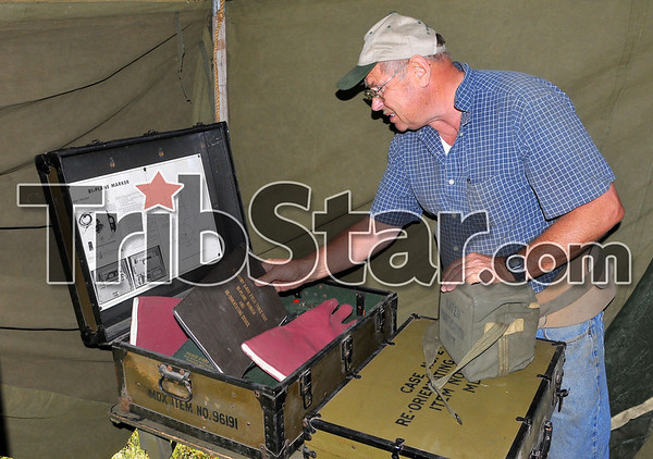 Collector: Doctor Peter Kirsch of Louisville collects WWII operating room equipment. He has hundreds of vintage items on display at Victory Days at the Terre Haute International airport.