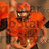 Orange speed: Paris High School's Jake Keys navigates the defense for a running play during team practice Wednesday in Paris.
