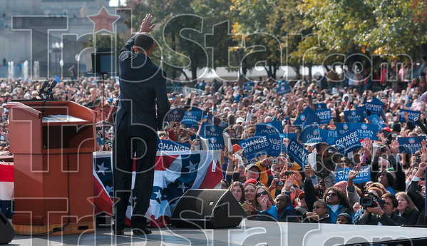 Thank you, Indianapolis: Democratic presidential candidate Barack Obama waves good-bye to members of the audience after his speech during the Early Vote for Change Rally Thursday on the American Legion Mall in Indianapolis.