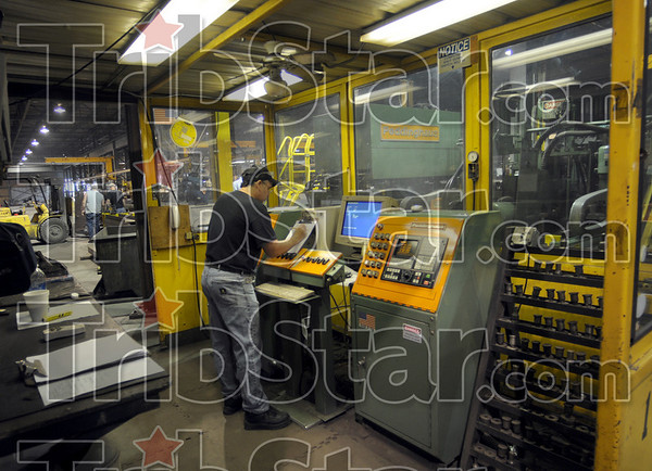 High tech: Lexnex Steel Company employee Brad Richardson operates cutting and punching equipment during his shift Friday at the Terre Haute plant.