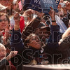 Believers in change: Barack Obama supporters applaud as the democratic presidential candidate finishes his speech Thursday on the American Legion Mall in Indianapolis.
