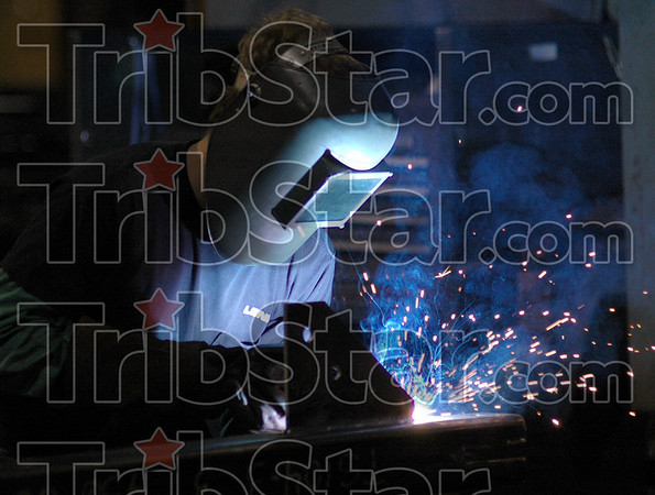 Making steel: A Lexnex Steel Company employee welds a steel beam in the Terre Haute plant Friday morning.