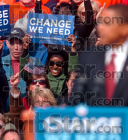 Sign of change: A member of the audience behind Barack Obama holds up a sign as she and fellow members of the audience applaud the democratic presidential candidate's speech Thursday on the American Legion Mall in Indianapolis.