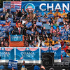 Audience participation: Democratic presidential candidate Barack Obama pauses as members of the audience applaud, cheer and wave signs during his speech on the American Legion Mall Thursday in Indianapolis.