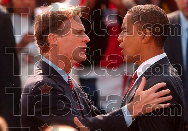 Good luck: Senator Evan Bayh congratulates democratic presidential candidate Barack Obama after Obama's speech for the Early Vote for Change Rally Thursday in Indianapolis on the American Legion Mall.