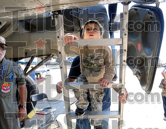 "Tour: Two-year-old Thad Balitewicz climbs aboard the ""Memphis Belle"" bomber to take a tour during Sunday's Victory Day event at Hulman International Airport."