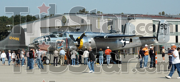 Display: Spectators surround one of the many vintage military aircraft on display at Victory Days Sunday morning.