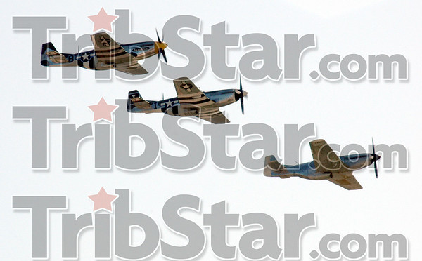 Fly-over: Three vintage fighters fly over Hulman International Airport Sunday afternoon during the Victory Days event.