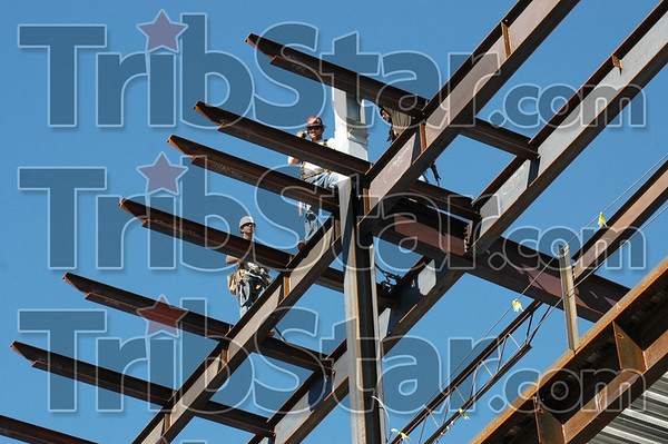 Walking the steel: Ironworkers walk the steel on the Union Hospital project Friday afternoon. The steel for the project was produced by the local Lenex Steel Company.