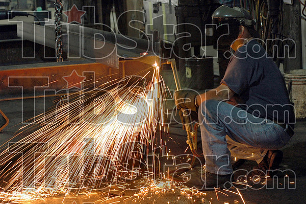 Cutting : A Lexnex Steel Company employee uses a cutting torch during his day at the steel plant Friday.
