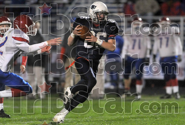 Caught and gone: Terre Haute North tight end Billy Sisson catches a pass from quarterback Chris O'Leary on his way to running in a touchdown out of the reach of a Martinsville defender during the Patriots' sectional win Friday at North.