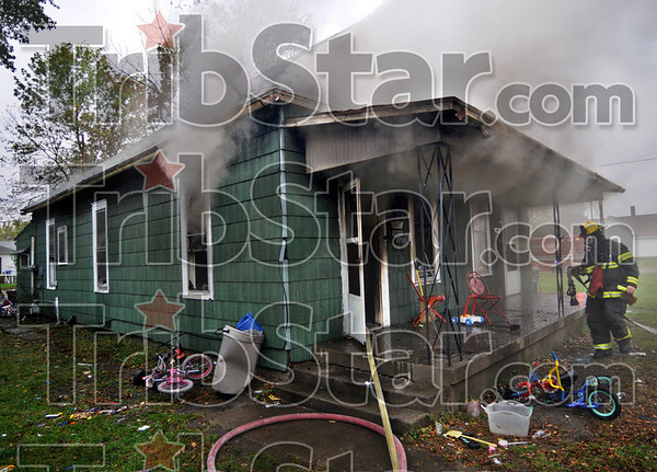 Fire scene: A home at 1405/07 Woodley avenue was destroyed by fire Friday afternoon.