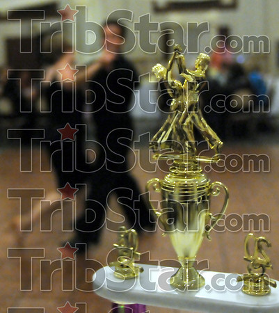 Trophy time: A couple practices their moves prior to the Dancing with the Terre Haute Stars competition Friday night.