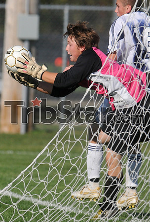 Goalie grab: South Vermillion goalie Zack Naylor grabs the ball as it bounces out of bounds out of the reach of Terre Haute North's Parker Victor Saturday during the boys' soccer sectional at North.
