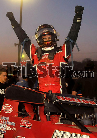 Inaugural win: Robert Ballou raises his hands in victory after he won the inaugural Clabber Girl Don Smith Classic presented by Indiana State University Sunday, May 4 at the Terre Haute Action Track.
